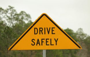 "A road sign reading ""drive safely""."