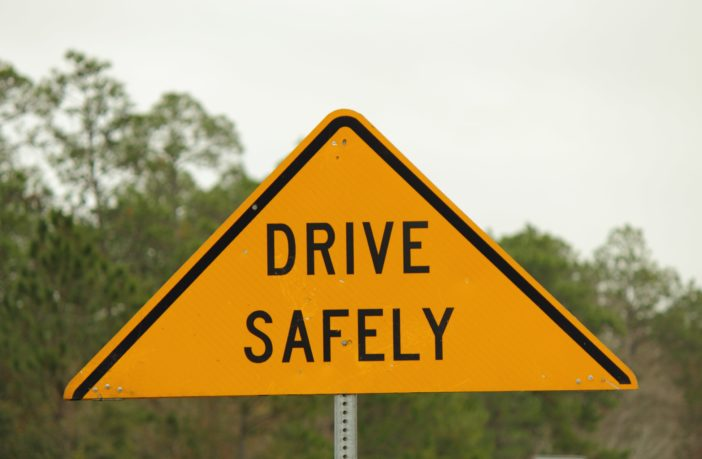"""A road sign reading """"drive safely""""."""